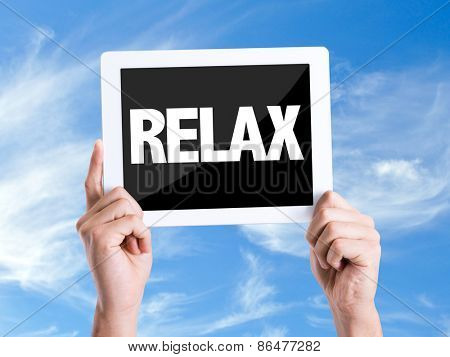Tablet pc with text Relax with sky background