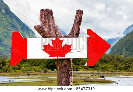 Canada wooden sign with mountains background
