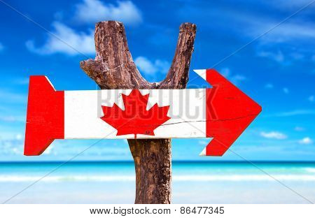 Canada wooden sign with ocean background