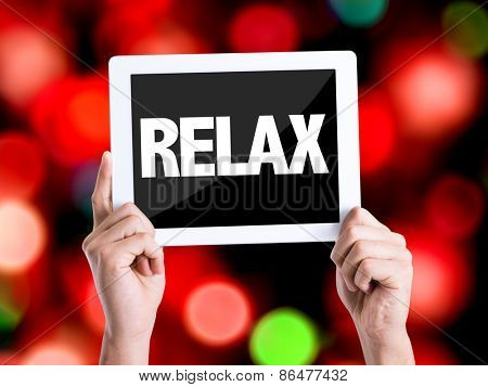 Tablet pc with text Relax with bokeh background