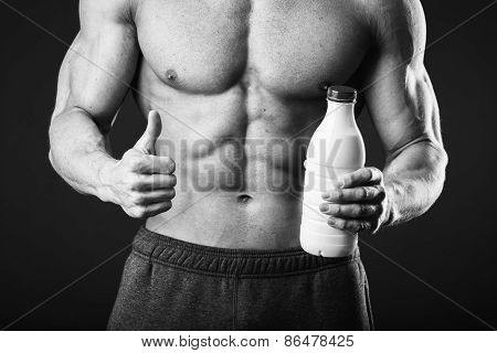 Man is holding a sports drink