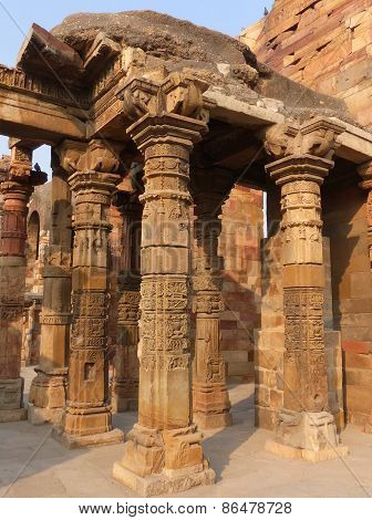 Columns With Stone Carving In Courtyard Of Quwwat-ul-islam Mosque, Qutub Minar, Delhi, India