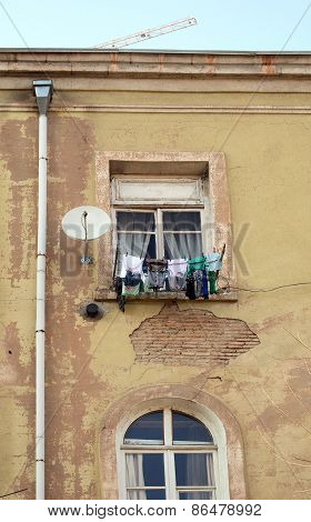 The windows of an apartment house and laundry on a clothesline