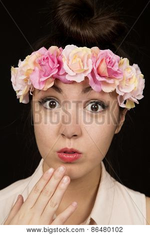 Gorgeous Teen Girl Wearing Floral Crown With A Suprised Expression