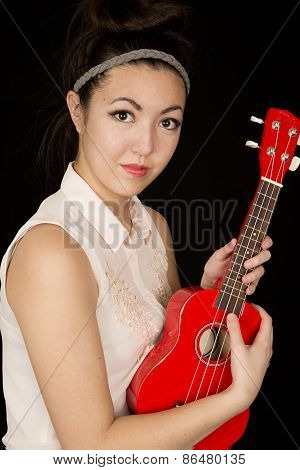Asian American Teen Beauty Holding Her Red Ukulele