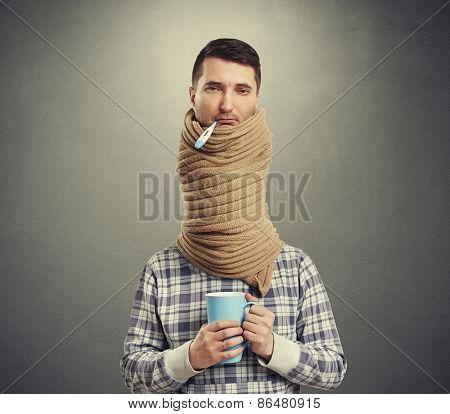 sad man with long neck coiled scarf over dark background