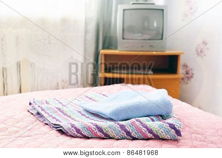 Closeup of towels on the bed