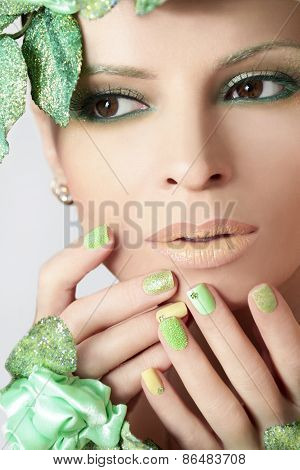 Green makeup and nail Polish .