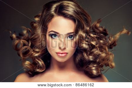 Beautiful girl model with  brown curled hair