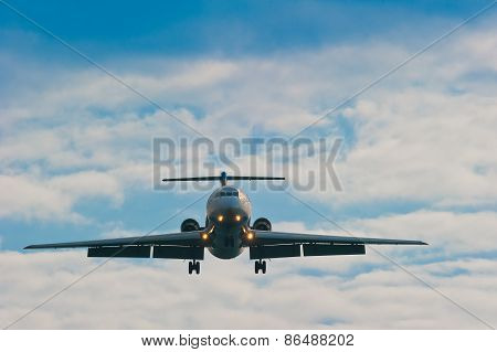 Plane On Sky Background With Gear And Flaps Ready For Planting