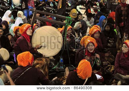 Women making music with drums, Yogyakarta city festival parade