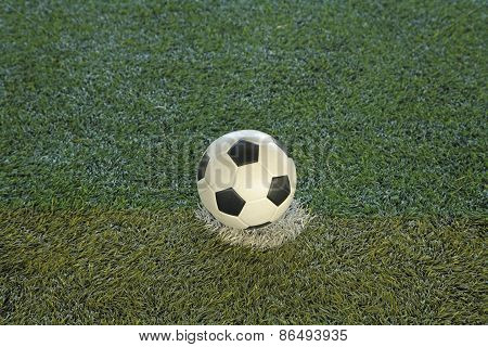 Soccer Ball At Kick-off Spot On Fake Grass Field