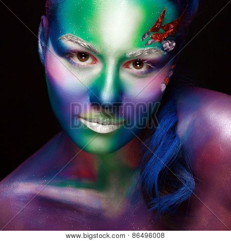 Portrait of beautiful woman with body art. underwater concept