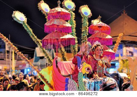 Women and men dressed as royalty, Yogyakarta city festival parade
