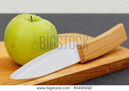 Wet Green Apple And Knife