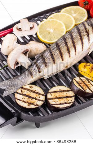 Grilled fish with vegetables.