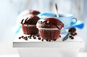 pic of chocolate muffin  - Tasty homemade chocolate muffins and cup of coffee on wooden table - JPG