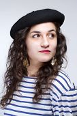 image of french beret  - Young Woman with French Style Beret Hat and Striped T - JPG