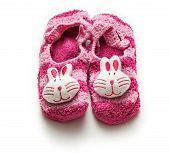 stock photo of booty  - Knitted purple booties with rabbit muzzle over - JPG
