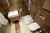 stock photo of tile  - View from the top of small bathroom with brown tiles - JPG
