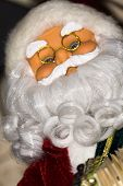 foto of accordion  - Christmas santa toy playing the accordion holiday background - JPG