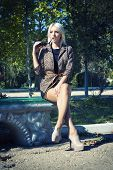 picture of slender legs  - Fashion photo of beautiful slender girl model in leopard print jacket with sunglasses - JPG