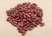 stock photo of kidney beans  - Dry beans kidney heap on the wood background - JPG