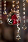 stock photo of vintage jewelry  - vintage bokeh exhibit jewelry flower pendant in glass rose - JPG