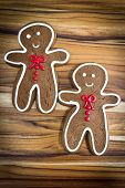 picture of gingerbread man  - holiday classic a gingerbread man cookies on a wooden table - JPG