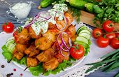 stock photo of kebab  - Chicken kebab with tomatoes on a wooden table - JPG