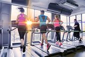 pic of treadmill  - group of young people running on treadmills in modern sport  gym - JPG