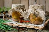 image of hermetic  - Canned meat in a glass jar on a wooden table - JPG