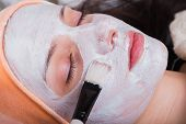 picture of black woman spa  - Young woman at spa procedures applying mask - JPG