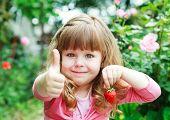 stock photo of strawberry blonde  - Little girl eating ripe strawberries - JPG