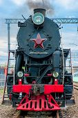 picture of steam  - old steam locomotive with smoke travels on rails - JPG