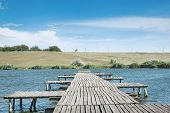 stock photo of pier a lake  - old wooden pier on a clean deep lake - JPG