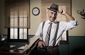 picture of 1950s style  - Smiling businessman leaving office holding briefcase and trench coat 1950s style - JPG