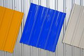 stock photo of roofs  - Metal roof painted by silver blue yellow color for sale - JPG