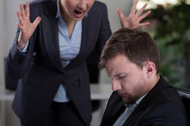 stock photo of inappropriate  - Female boss yelling at employee at work - JPG