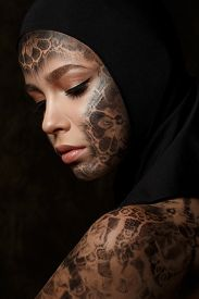 picture of wraith  - Portrait of young beautiful woman with bodyart over dark background - JPG