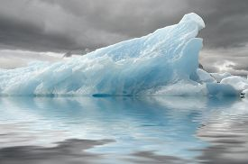 picture of iceberg  - Color blue is typical of the icebergs formed in the glacial lagoon due to the disintegration of the glacier front - JPG