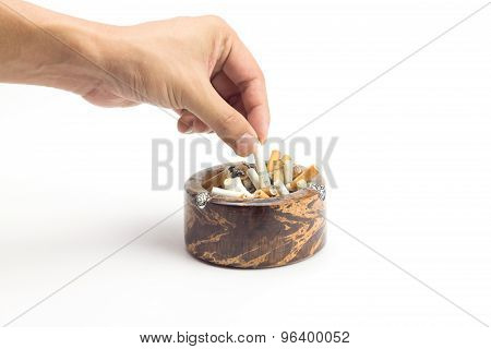 Hand Holding Butt Cigarette And Ashtray