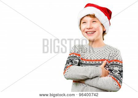 Portrait of a boy in christmas hat with happy and joyful facial expression
