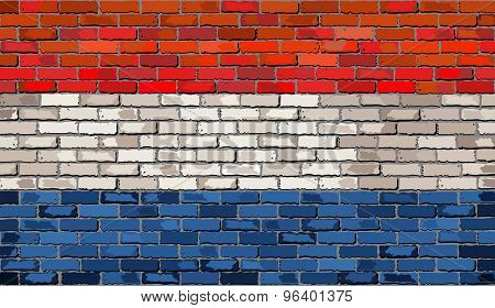 Grunge Flag Of Netherlands On A Brick Wall