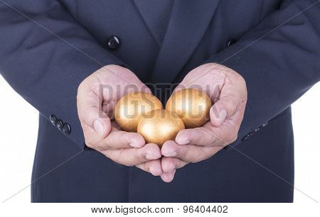 Businessman Showing Golden Egg. Concept Business