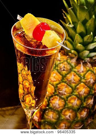 Champagne  cocktail with whole pineapple with leaves .