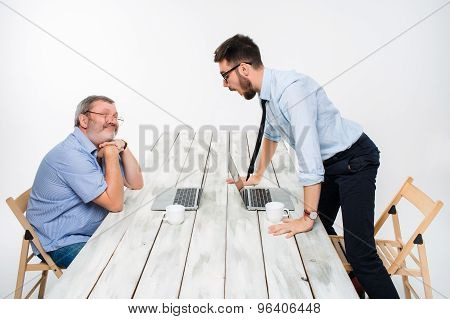The two colleagues working together  at office on gray background