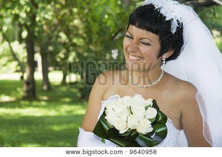 One happy bride outdoors.