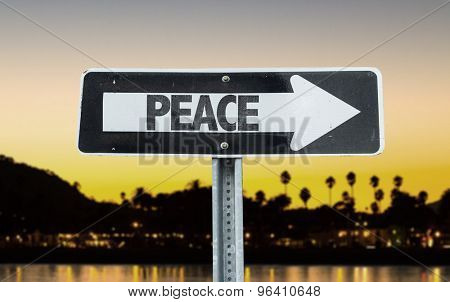 Peace direction sign with sunset background