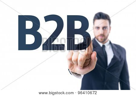 Business man pointing the text: B2B